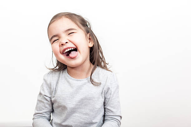 Smiling small girl on the white background